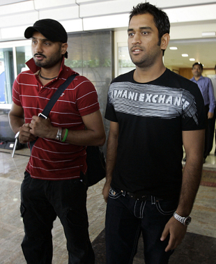 Harbhajan Singh and MS Dhoni Mahendra Singh Dhoni leave the BCCI head office after a meeting with ICC officials, Mumbai, August 2, 2009