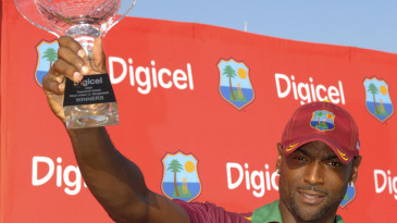 Floyd Reifer holds aloft the winners' trophy after West Indies beat Bangladesh by five wickets