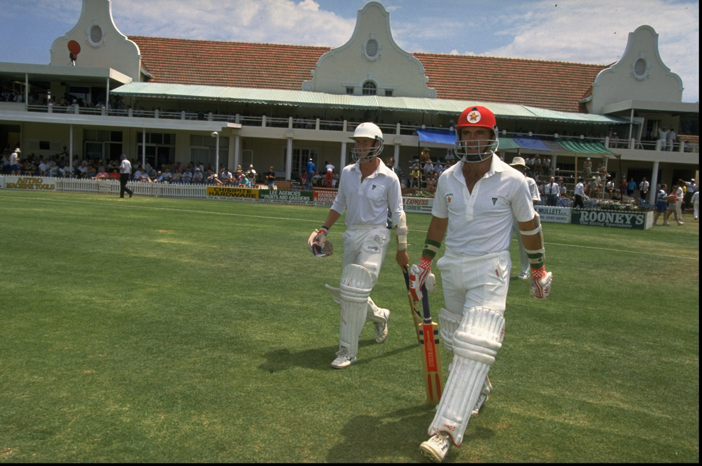 Pioneers: Grant Flower (left) and Kevin Arnott walk out to bat in Zimbabwe's inaugural Test