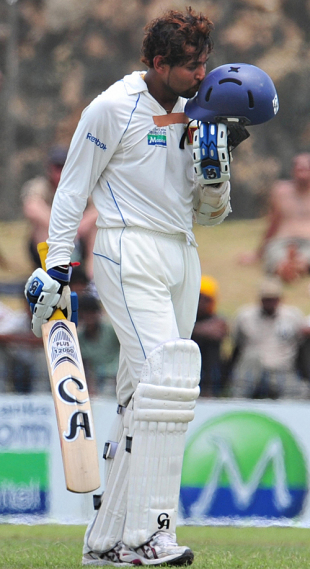 Tillakaratne Dilshan kisses his helmet on getting to his half-century, Sri Lanka v New Zealand, 1st Test, Galle, 1st day, August 18, 2009