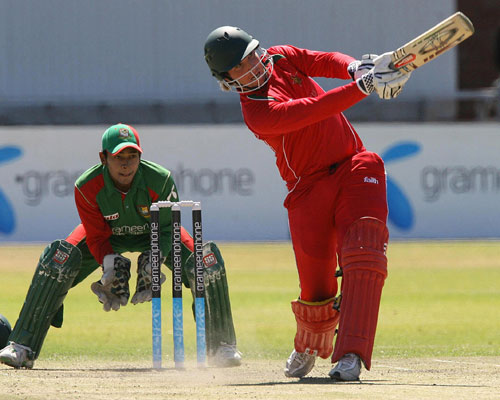 Brendan Taylor launches the  ball towards long-on