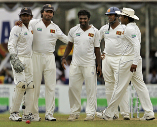 Team-mates crowd around Muttiah Muralitharan after he dismissed Iain O'Brien, Sri Lanka v New Zealand, 1st Test, Galle, 4th day, August 21, 2009
