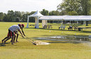 Groundsmen work to remove water from the ground, Canada v Kenya, 2nd ODI, King City, August 22, 2009