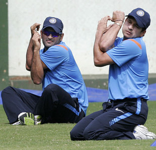 Sachin Tendulkar and MS Dhoni stretch at the National Cricket Academy, Bangalore, August 30, 2009