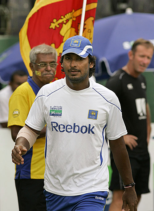 The victorious captain Kumar Sangakkara walks to pick up the series trophy