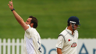 Steffan Jones celebrates the wicket of Rob Key