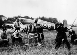 RAF pilots relax with an impromptu game of cricket, June 20, 1941
