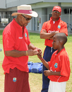 Sir Garry Sobers shows a youngster the proper bowling grip, Barbados, September 7, 2009