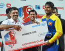 Kumar Sangakkara is all smiles after picking up the winner's cheque, Sri Lanka v New Zealand, 1st match, Compaq Cup, Colombo, September 8, 2009