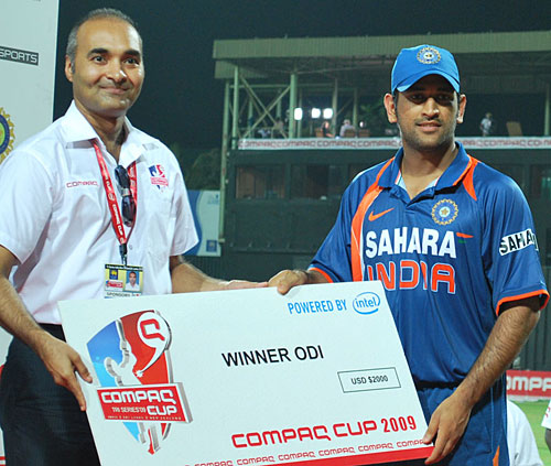 ms dhoni is presented with the winning teams cheque photo compaq cup espncricinfo