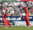 Graeme Swann steadies himself under James Hopes' leading edge