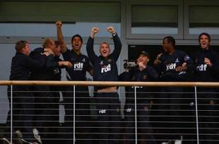 The Sussex players celebrate after Durham's victory over Somerset gives them the Pro40 title
