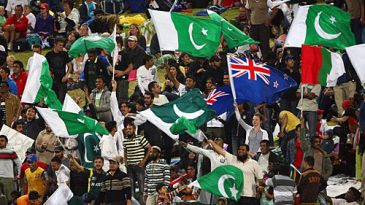 A New Zealand flag among the Pakistan ones