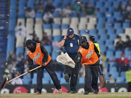 Groundstaff try to clear another invasion of flying ants