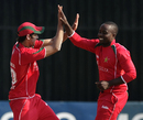 Prosper Utseya and Graeme Cremer celebrate a wicket, Zimbabwe v Kenya, 1st ODI, Harare, October 12, 2009