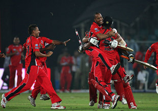 T&T players launch themselves on Kieron Pollard after their four-wicket win, New South Wales v Trinidad & Tobago, Champions League Twenty20, League A, Hyderabad, October 16, 2009