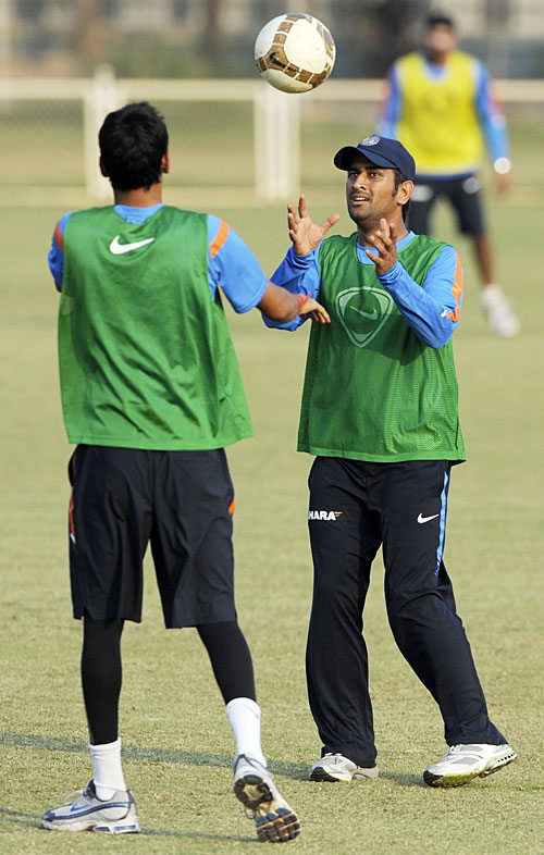 MS Dhoni warms up before a practice football match