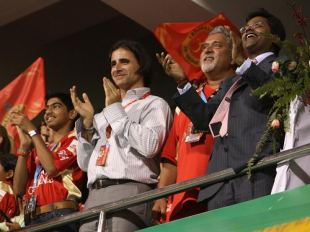 (From left) Dean Kino, head of the Champions League governing council, Bangalore Royal Challengers owner Vijay Mallya, and Lalit Modi, Chairman of the Champions League, applaud the action