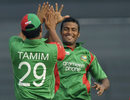 Nazmul Hossain and Tamim Iqbal celebrate a wicket