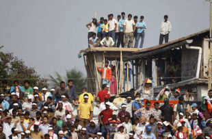 Fans watch from an under-construction building adjoining the stadium, India v Australia, 6th ODI, Guwahati, November 8, 2009