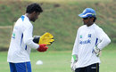 Prasanna Jayawardene discusses a point with Kaushal Silva