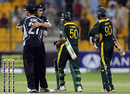Tim Southee and Shane Bond celebrate, Saeed Ajmal and Mohammad Aamer trudge off, Pakistan v New Zealand, 3rd ODI, Abu Dhabi, November 9, 2009