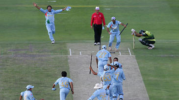 The winning moment - Misbah-ul-Haq rues his luck as the Indians celebrate