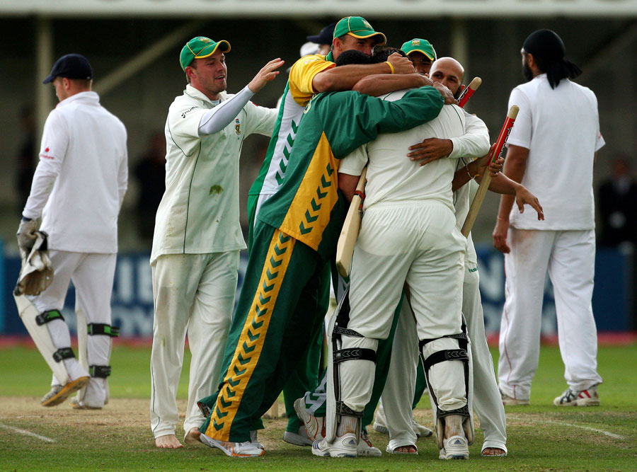 Graeme Smith is mobbed by his team-mates after leading South Africa to their first series victory in England since 1965