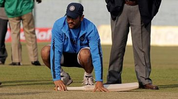 MS Dhoni inspects the Green Park pitch