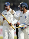 Pragyan Ojha gets the congratulations from MS Dhoni as India walk off victorious, India v Sri Lanka, 2nd Test, Kanpur, 4th day, November 27, 2009