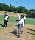 Sri Lanka Cricket chairman Somachandra de Silva sends down the first ball at the Pallekele Stadium, November 27, 2009