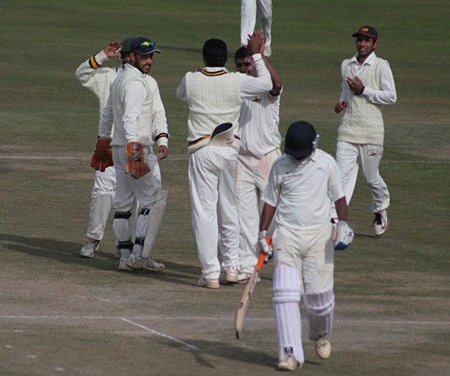 Himachal Pradesh players celebrate an Orissa wicket