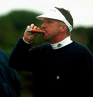 Ian Botham takes a sip from his hip flask as tennis player Ivan Lendl looks on ahead of the Alfred Dunhill Cup, Scotland, October 10, 2000