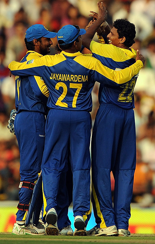 The Sri Lankan fielders celebrate Suraj Randiv's first ODI wicket