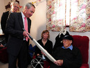 Eric Tindill, the oldest Test cricketer, is presented a signed bat by the New Zealand Cricket chairman Alan Isaac on his 99th birthday, Wellington, December 18, 2009