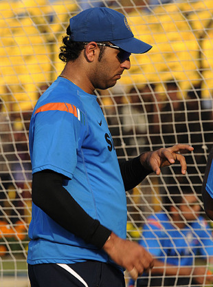 Yuvraj Singh checks if his finger has healed, Cuttack, December 20, 2009