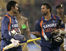 Sachin Tendulkar makes a point to Dinesh Karthik after wrapping up the match, India v Sri Lanka, 3rd ODI, Cuttack, December 21, 2009