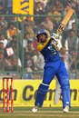 Tillakaratne Dilshan flays the bat and misses