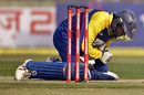 Tillakaratne Dilshan slumps to the ground after being struck