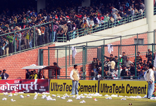 The Feroz Shah Kotla outfield stands littered with debris thrown by angry supporters after the match was abandoned, India v Sri Lanka, 5th ODI, December 27, 2009