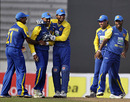 Thilan Samaraweera gets the congratulations after pouching Imrul Kayes