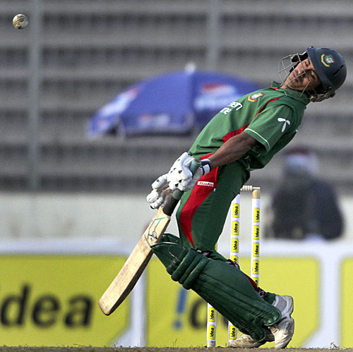 Mohammad Ashraful weaves away from a Suranga Lakmal bouncer