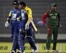 Kumar Sangakkara and Tillakaratne Dilshan bring up their century stand as Shakib Al Hasan looks forlorn
