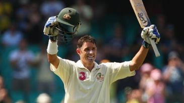 Michael Hussey acknowledges the applause for his century