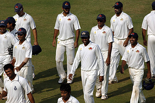 The victorious Mumbai team walks back after the match