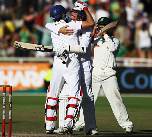 Graham Onions and Graeme Swann embrace after seeing out 17 balls to save England the Test