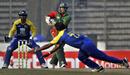 Malinga Bandara dives to stop a shot by Shakib Al Hasan, Bangladesh v Sri Lanka, Tri-series, 4th ODI, Mirpur, January 8, 2010