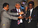 Bangladesh Cricket Board president Mostafa Kamal, the BCCI president Shashank Manohar and the Sri Lanka Cricket chairman D.S de Silva hold aloft the 2011 World Cup trophy, Dhaka, January 9, 2010