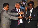 Bangladesh Cricket Board president Mostafa Kamal, the BCCI president Shashank Manohar and the Sri Lanka Cricket chairman D.S de Silva hold aloft the 2011 World Cup trophy, Dhaka, January 9, 2010