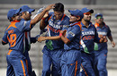Sudeep Tyagi is congratulated by his team-mates after getting rid of Upul Tharanga, India v Sri Lanka, Tri-series, 5th ODI, Mirpur, January 10, 2010